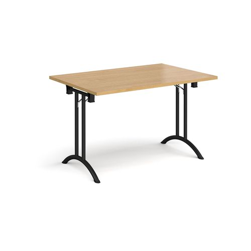 Rectangular folding leg table with black legs and curved foot rails 1200mm x 800mm - oak