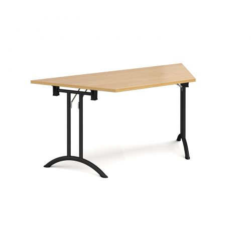 Trapezoidal folding leg table with black legs and curved foot rails 1600mm x 800mm - oak