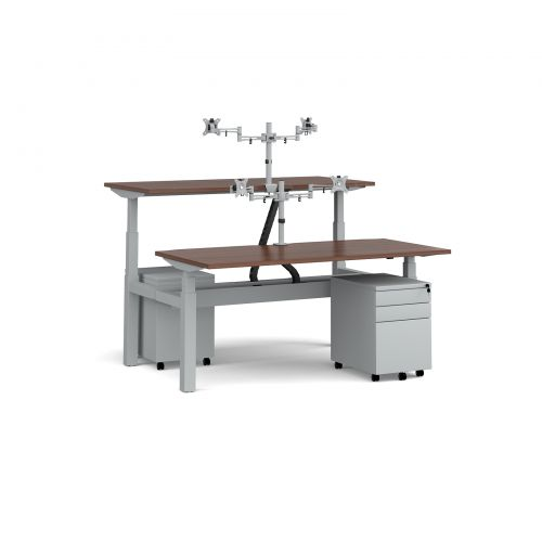 Elev8 Mono sit-stand back-to-back desks 1600mm - silver frame/walnut top with matching double monitor arms/steel pedestals and cable channel/chains