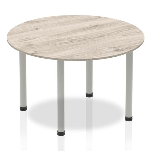 Impulse Circle Table 1200 Grey Oak Post Leg Silver