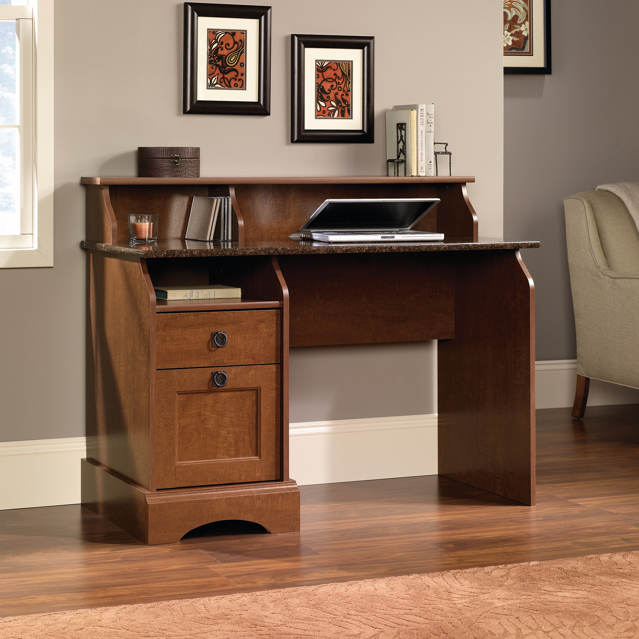 Teknik Office Farmhouse Desk with Autumn Maple Finish; a sunset granite accent desktop; two storage drawers and three storage cubbys