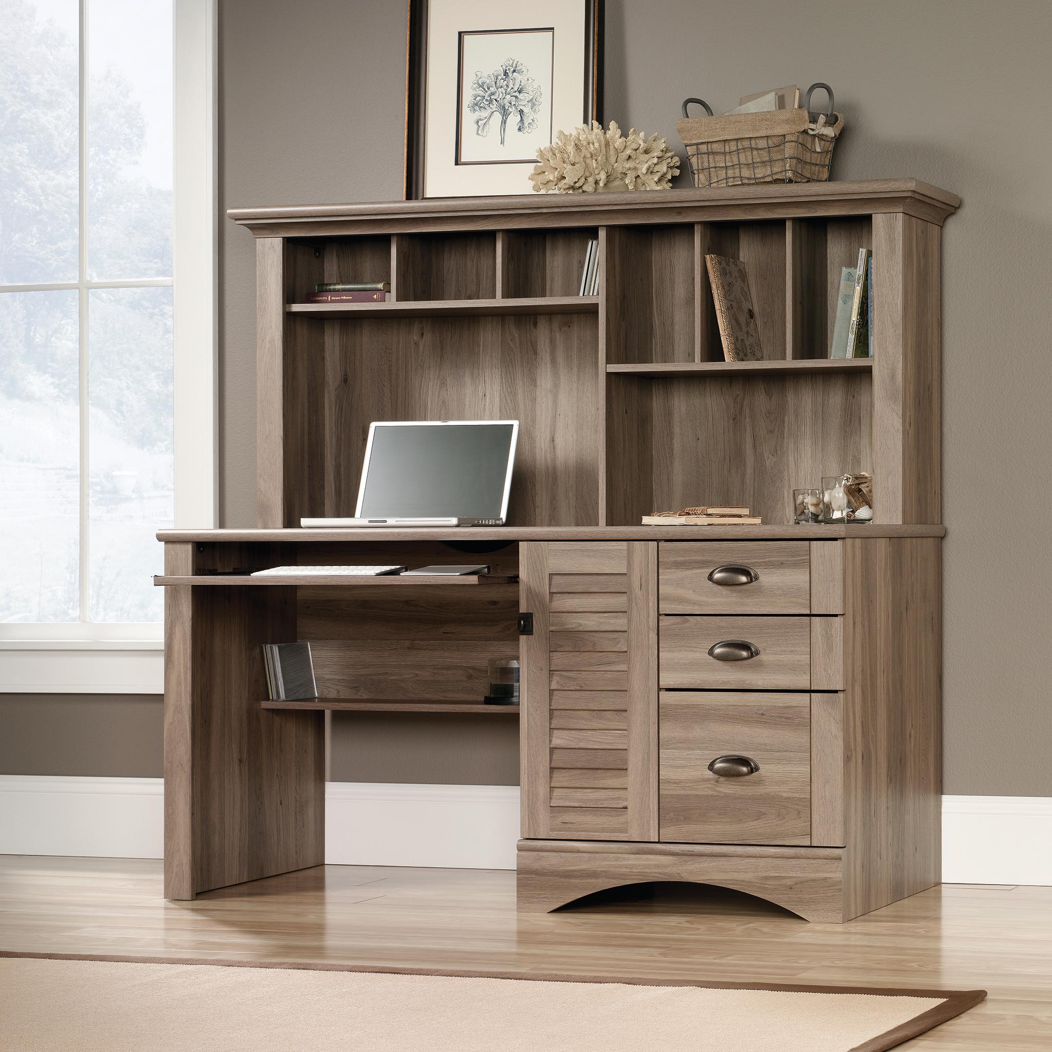Teknik Office Louvre Hutch Desk in a Salt Oak Finish; slide out keyboard / mouse shelf; multiple storage cubbyholes within the hutch and a filer drawe